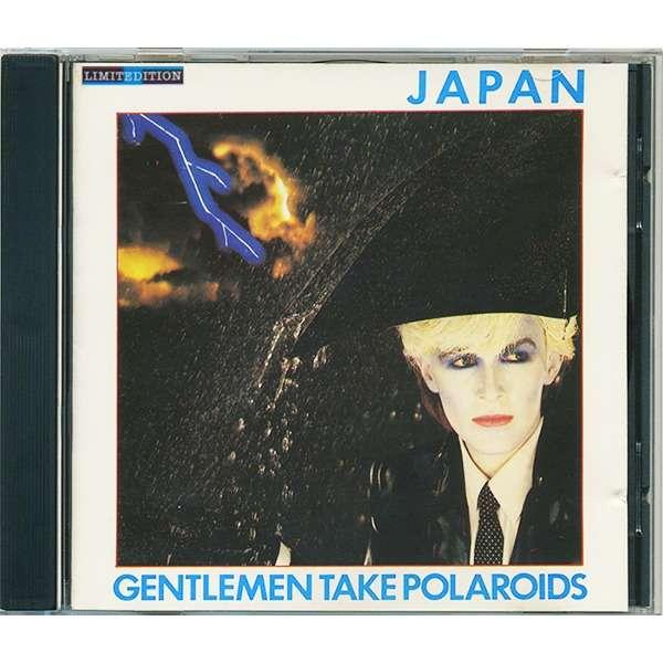 Japan Gentlemen take polaroids